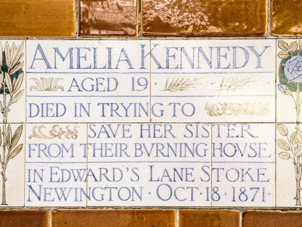A ceramic tile in Postman's Park, commemorating Amelia Kennedy