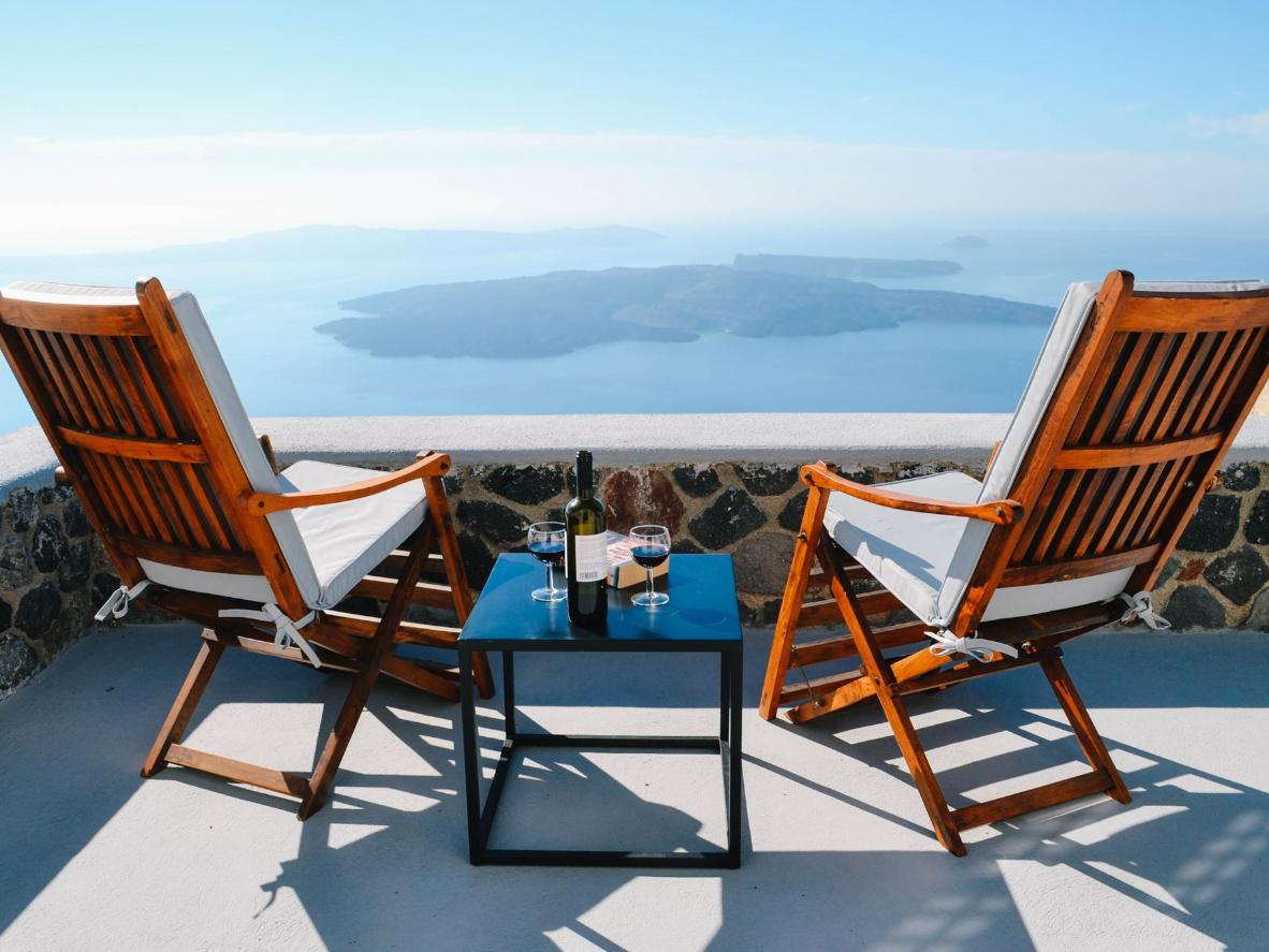 Have a glass of wine with a surreal Aegean Sea backdrop at Ikia Kriton