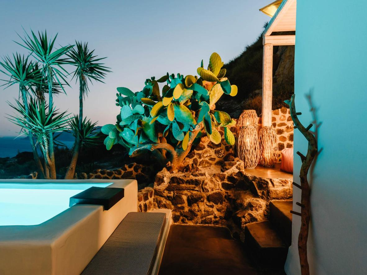 Solstice Luxury Suites's rooftop pool is the perfect setting for drinks after dark