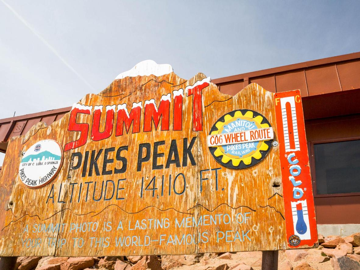 After 1,440 metres of gruelling ascent, you can touch the sign plate on top of the mountain