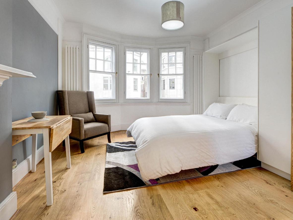 The studio's fold-up double bed makes clever use of the space