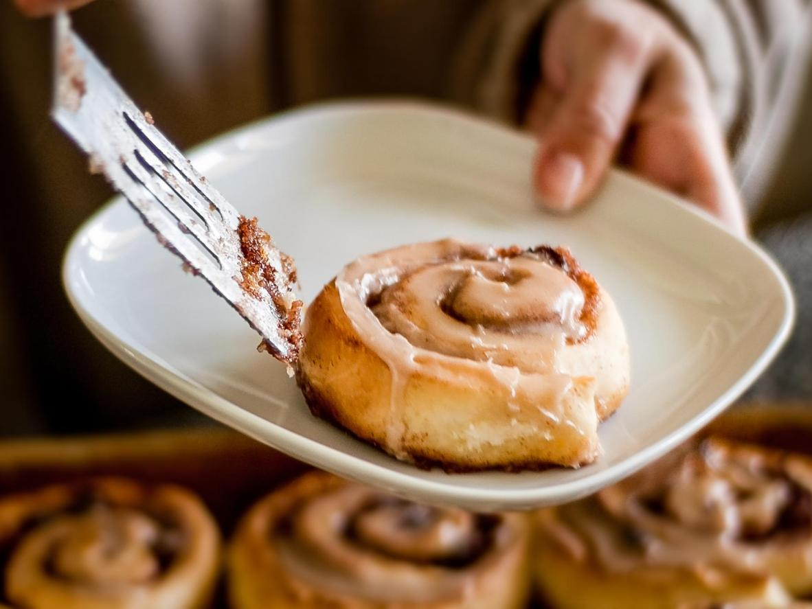 Try cinnamon rolls at The Cinnamon Snail food truck in NYC