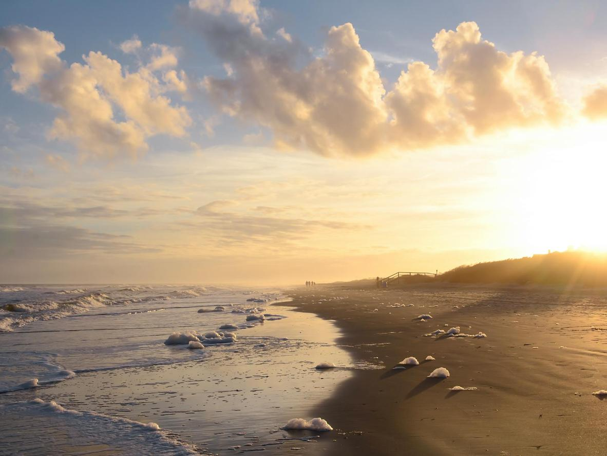 Find yourself a sheltered spot of sand to watch the sunset here