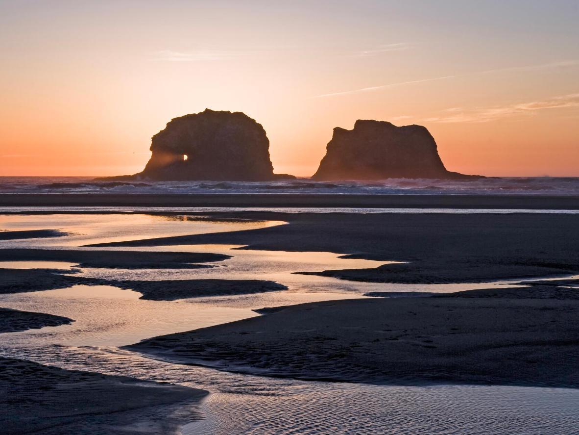 Don't miss a view of Rockaway Beach's twin rocks at sunset