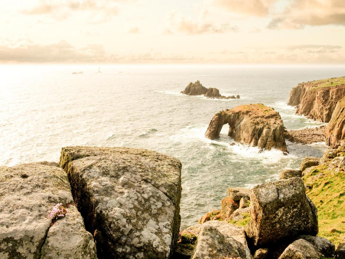 The moodily romantic, wave-buffeted, natural arch of Enys Dodman Rock