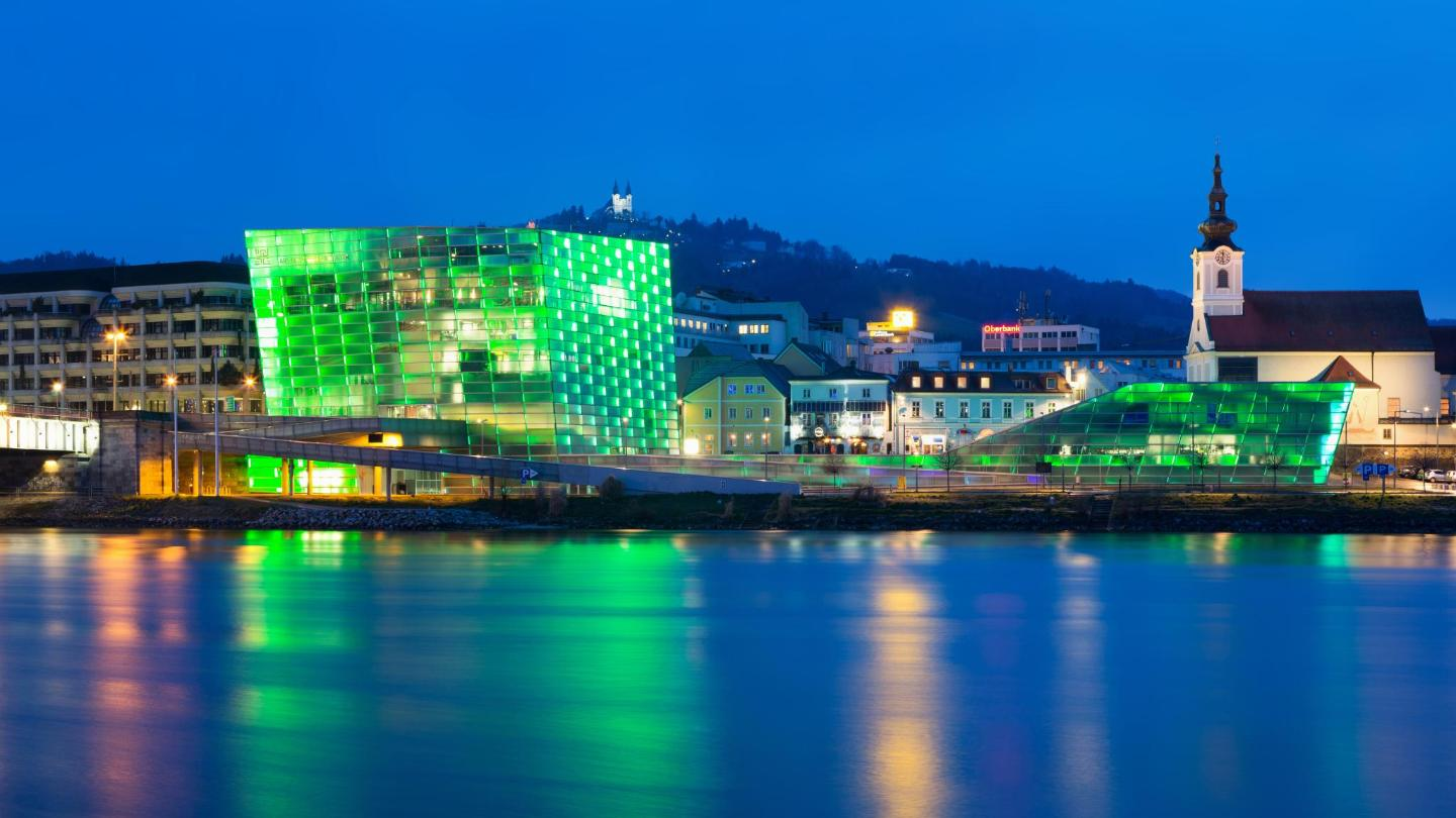 The Ars Electronica Center lit up at night, Linz