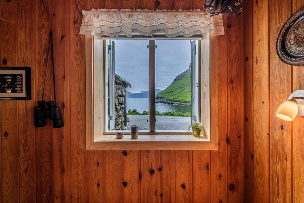 Дом для отпуска visitHOMES Elduvík - отзывы Booking
