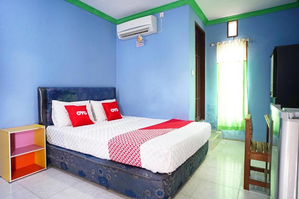 Отель Отель OYO 2343 Winolanto Guest House Syariah
