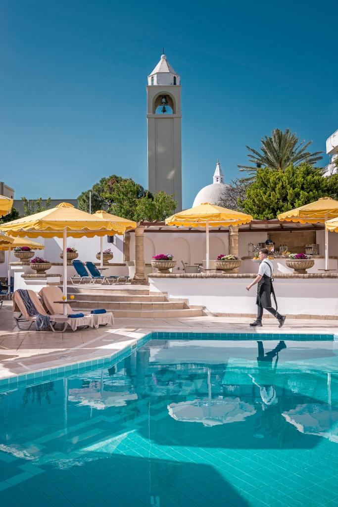 Отель  Mitsis Petit Palais Beach Hotel  - отзывы Booking