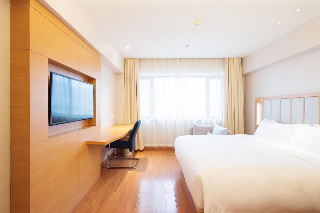 Отель  Crystal Orange Hotel (Harbin Convention and Exhibition Center Xuanyuan Road)  - отзывы Booking