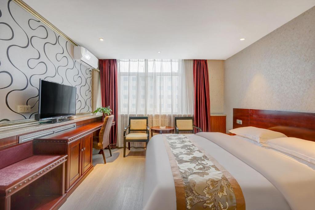 Отель  Jinbaoli Business Hotel  - отзывы Booking