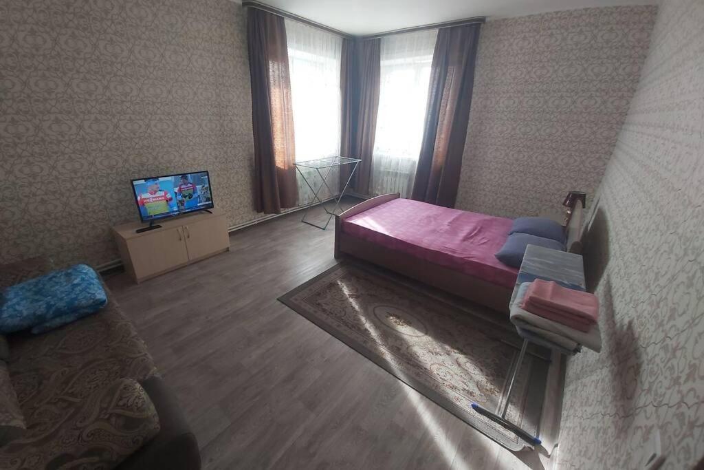 Апартаменты/квартира Уютная однокомнатная квартира на Цивилева 32