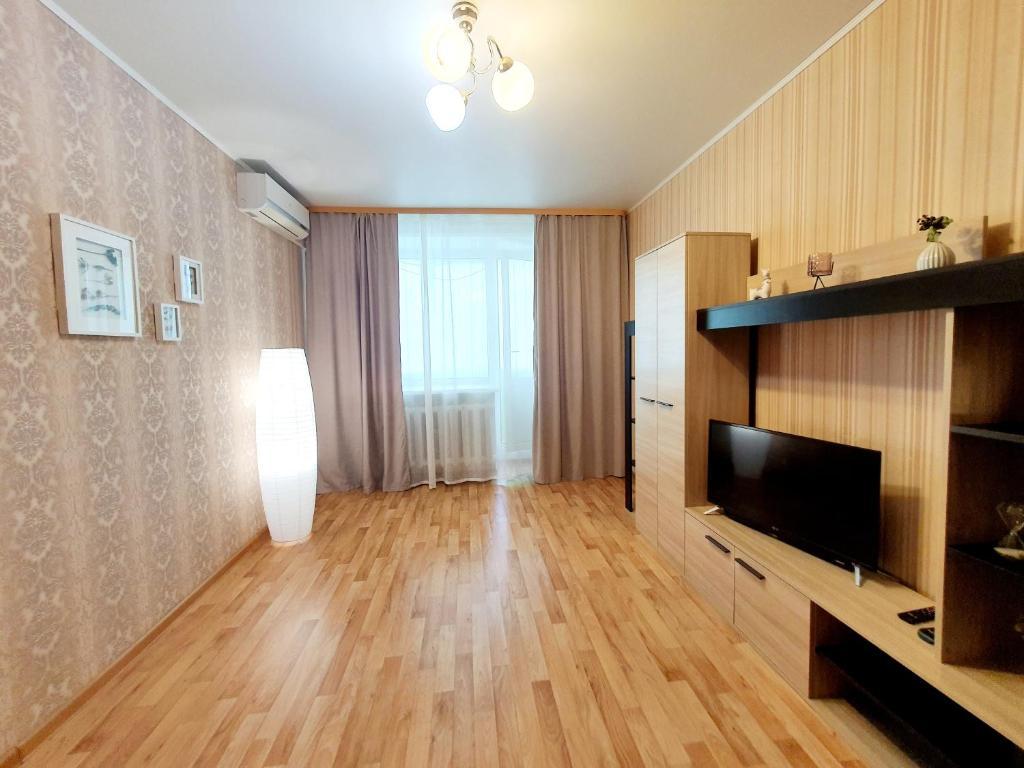 Апартаменты/квартира  Теплая уютная квартира в тихом районе - Комфортный сон - Большой балкон - Максимальная дезинфекция