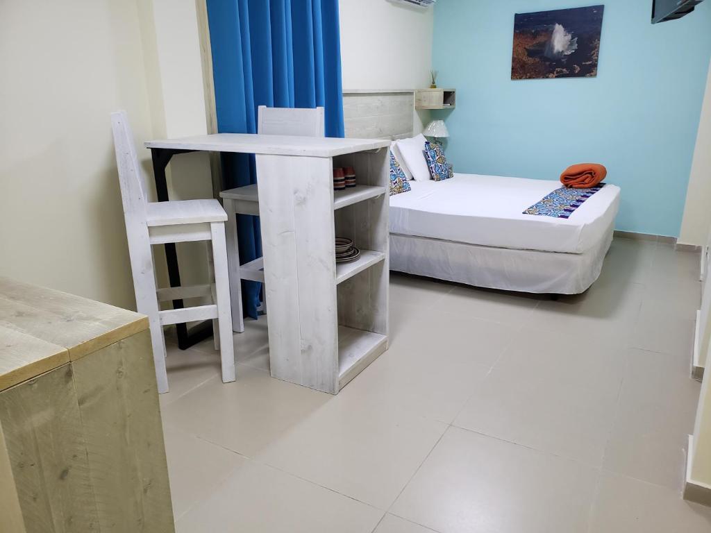 Отель  Отель  Mustique Suites Curacao