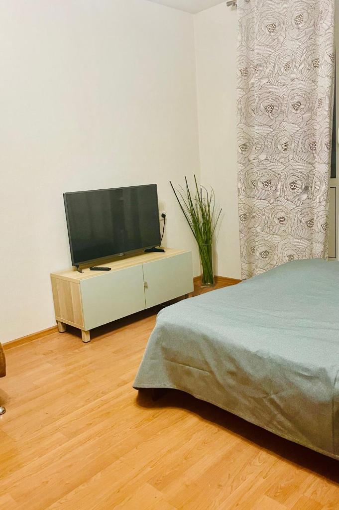 Апартаменты/квартира Квартира рядом с метро и парками