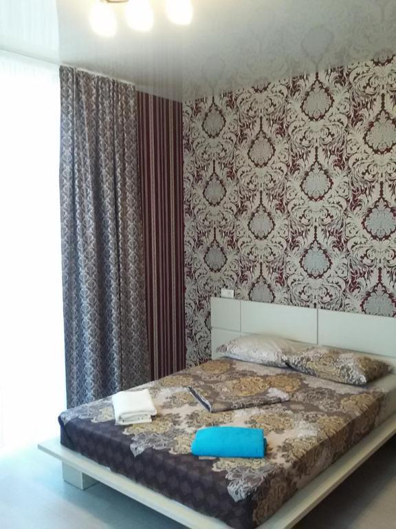 Кровать или кровати в номере Guest House Sevilya Гостевой Дом Севилья