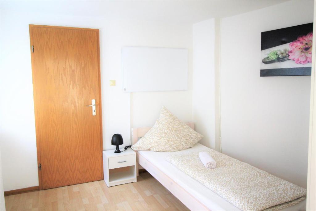 Ein Bett oder Betten in einem Zimmer der Unterkunft Ferienhaus in Zülpich