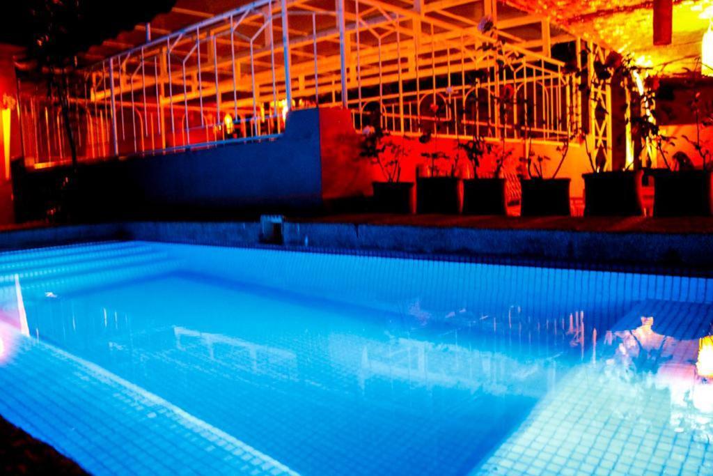 The swimming pool at or near Riad Dihya