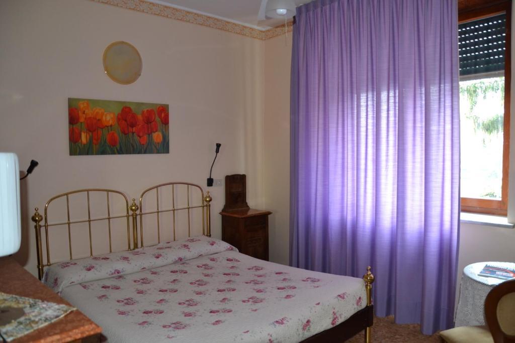 Letto o letti in una camera di Albergo Ristorante Garden
