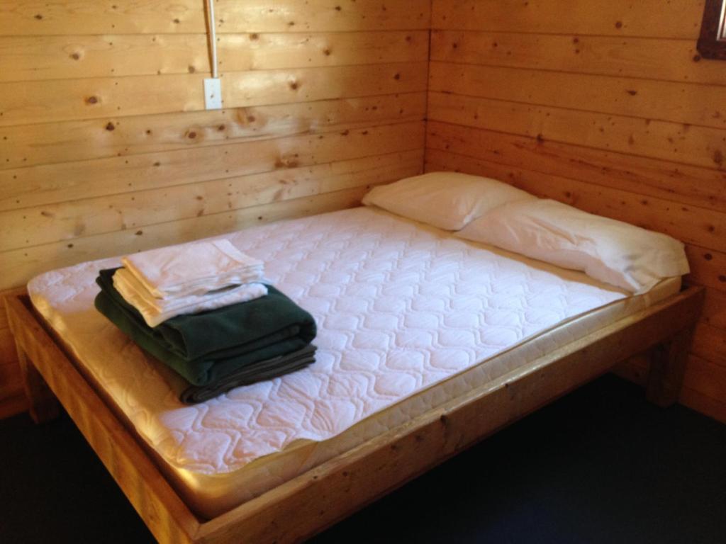 A bed or beds in a room at Salines de Gros-Cap