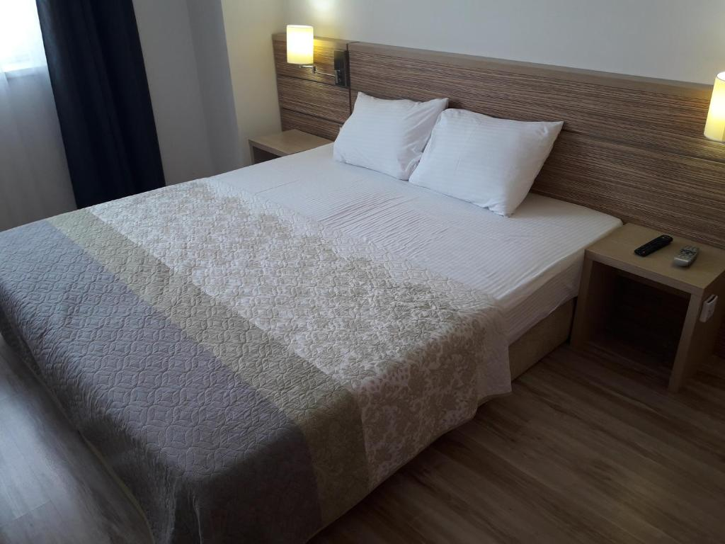 A bed or beds in a room at Bucharest Residence Apartment