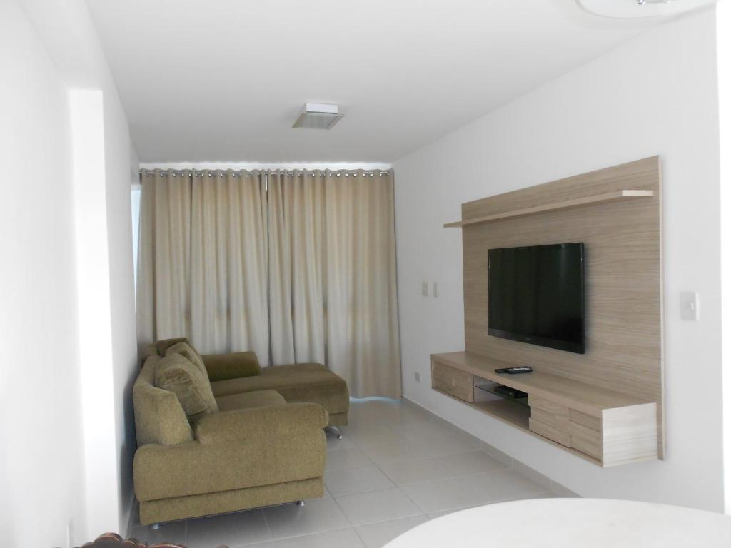 A seating area at Flat Beira Mar