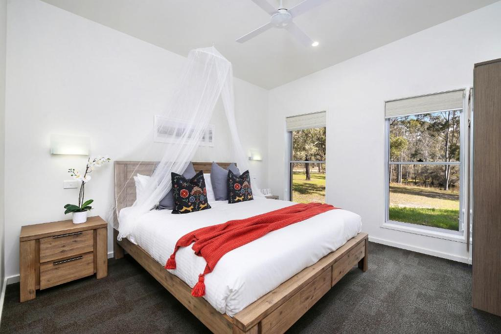 A bed or beds in a room at Ironbark Villa 1
