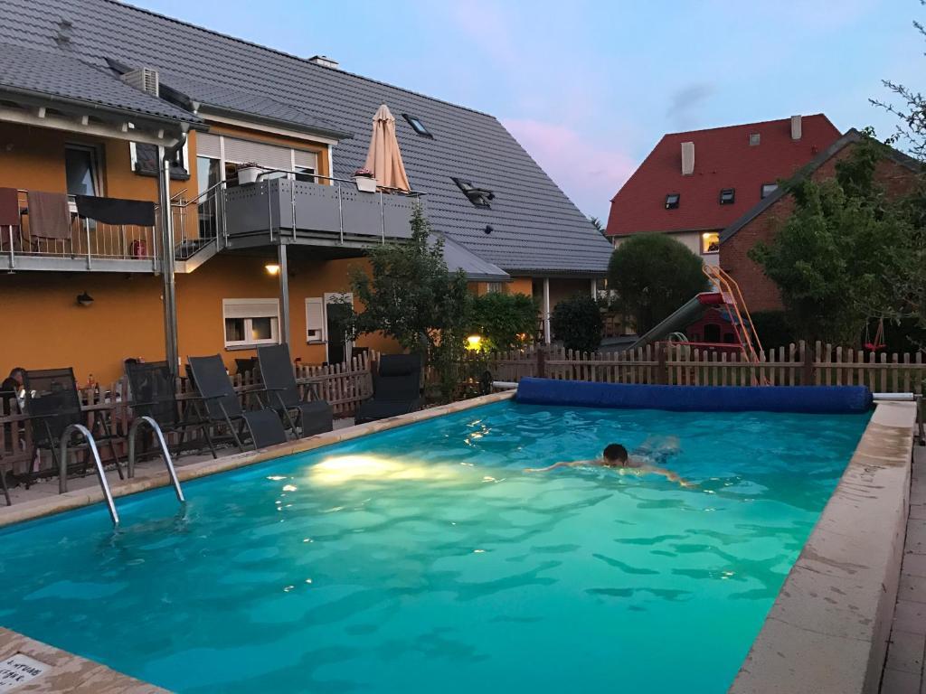 The swimming pool at or near Pension LeLiLa Rust - ex Gästehaus Milella - mit EP Ticket Garantie
