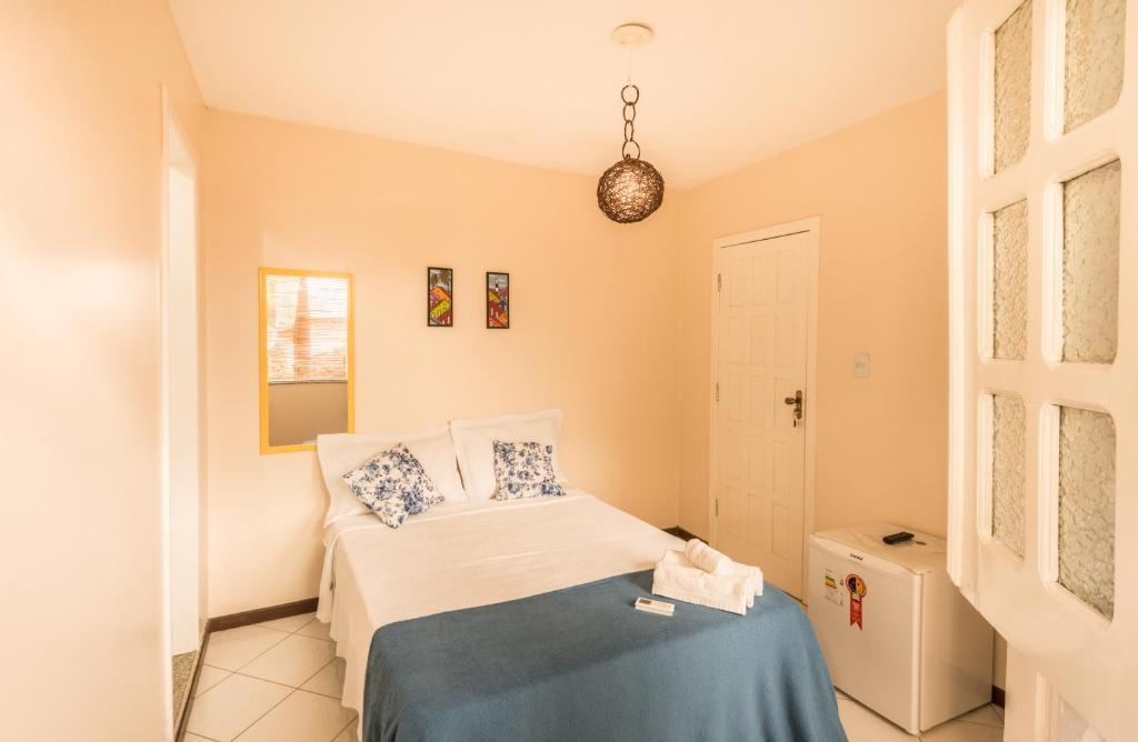 A bed or beds in a room at Pousada Vila dos Ventos