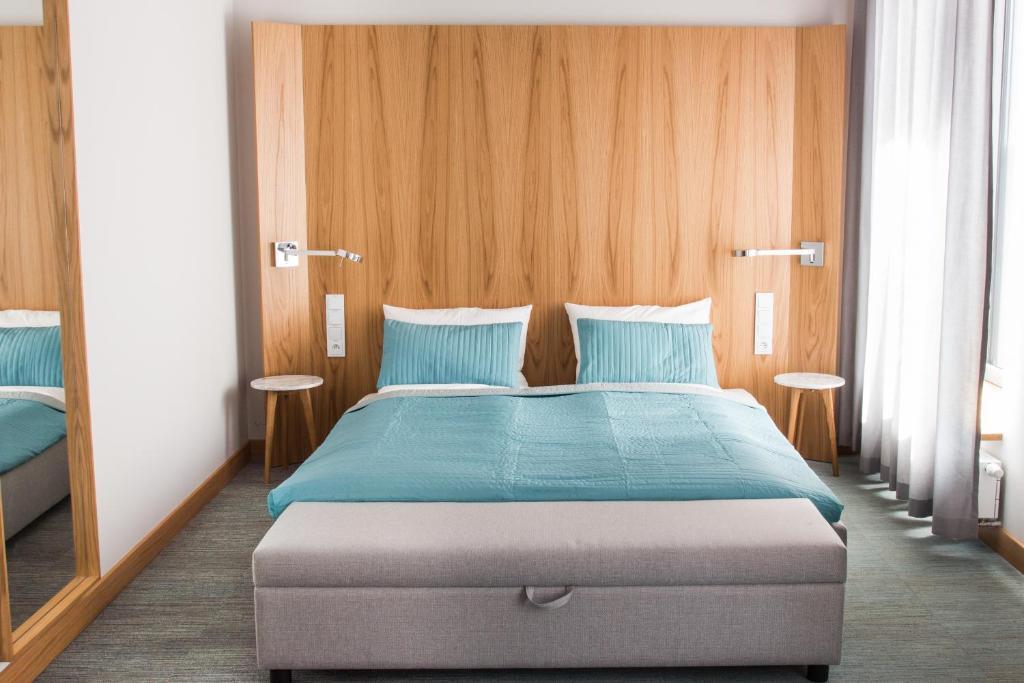 Łóżko lub łóżka w pokoju w obiekcie Apartamenty Muzeum II Wojny Światowej