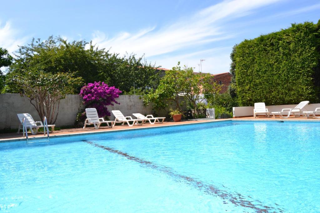 The swimming pool at or near Hotel Amandi