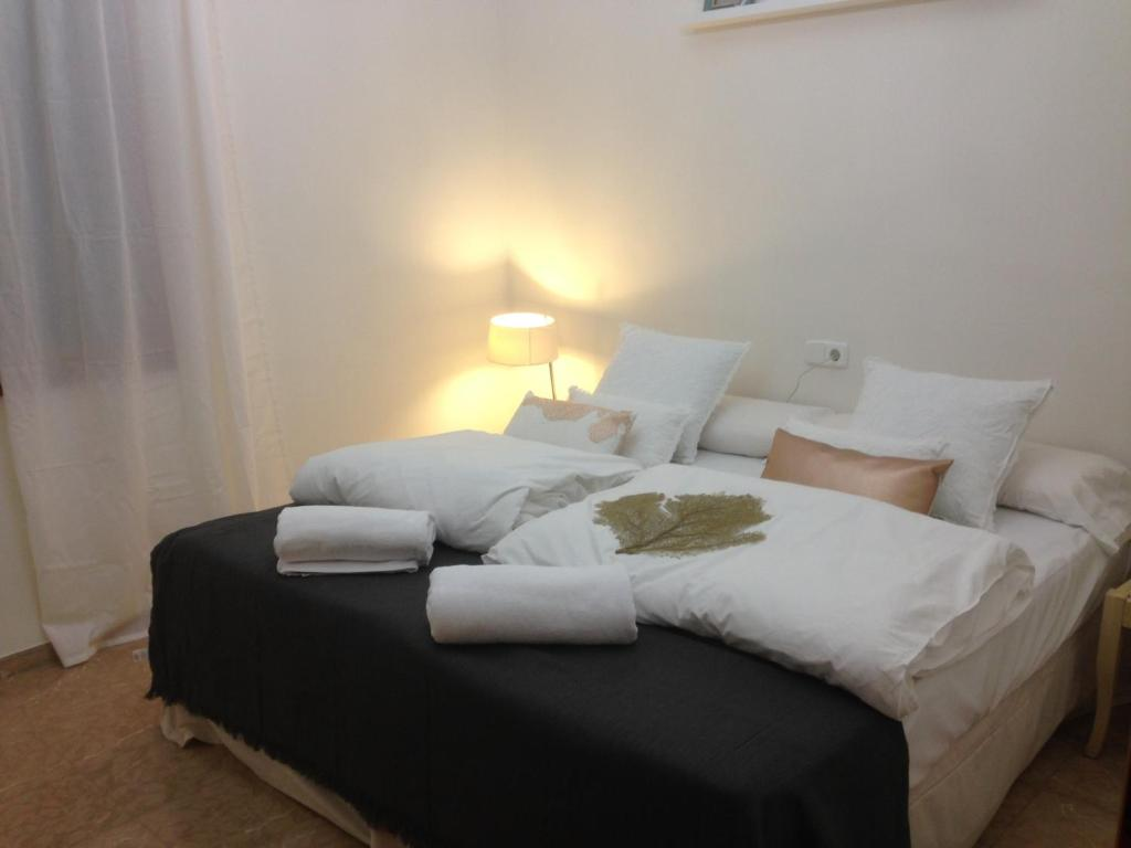 A bed or beds in a room at Playa de Palma Beach House