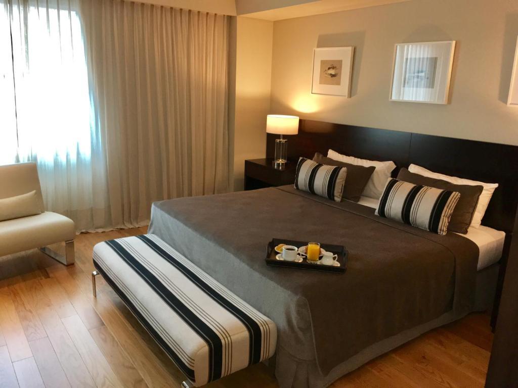 Cama ou camas em um quarto em Hotel Metropolitano Supara
