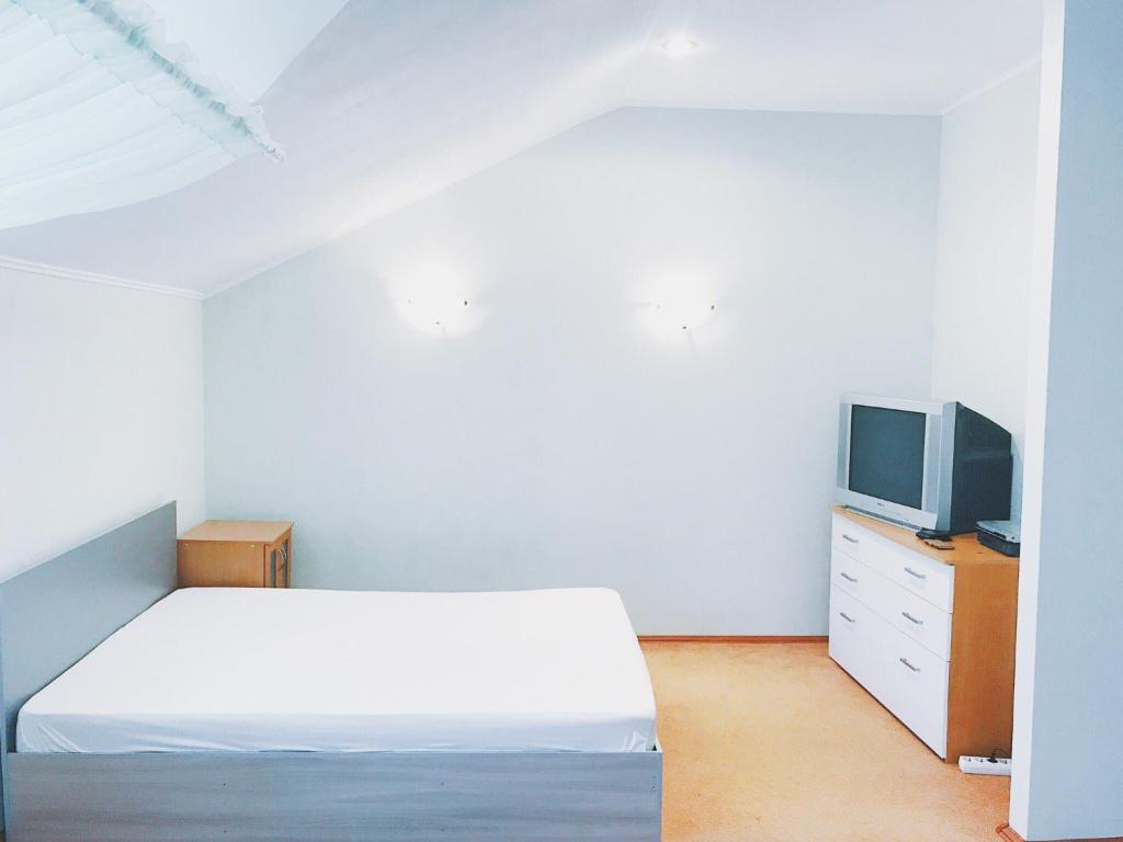 A bed or beds in a room at Apartments Altinay on Bannoe Lake