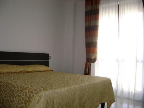 Un ou plusieurs lits dans un hébergement de l'établissement Residence Montegrappa