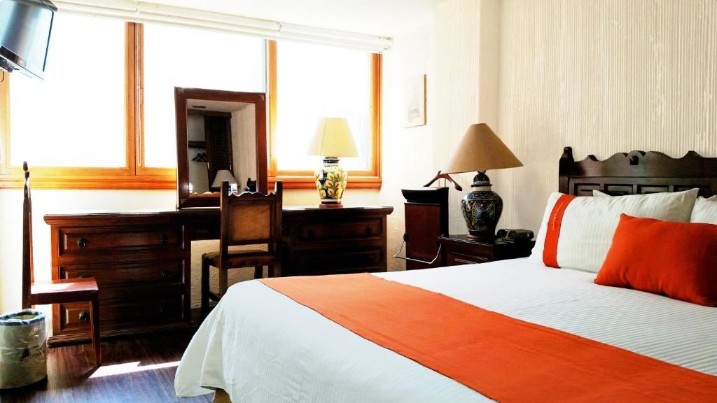 Кровать или кровати в номере Suites Amberes