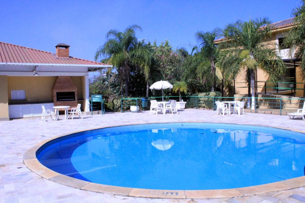 The swimming pool at or near Golden Park Hotel Viracopos