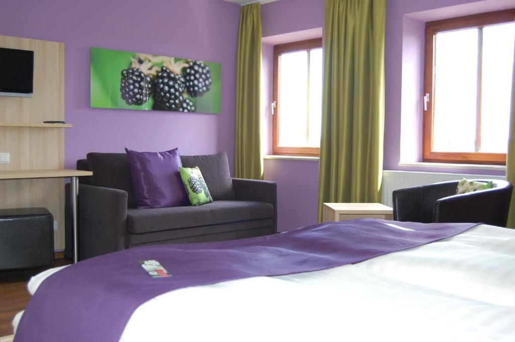 Ein Bett oder Betten in einem Zimmer der Unterkunft Gasthof Linden & Wildkräuterhotel