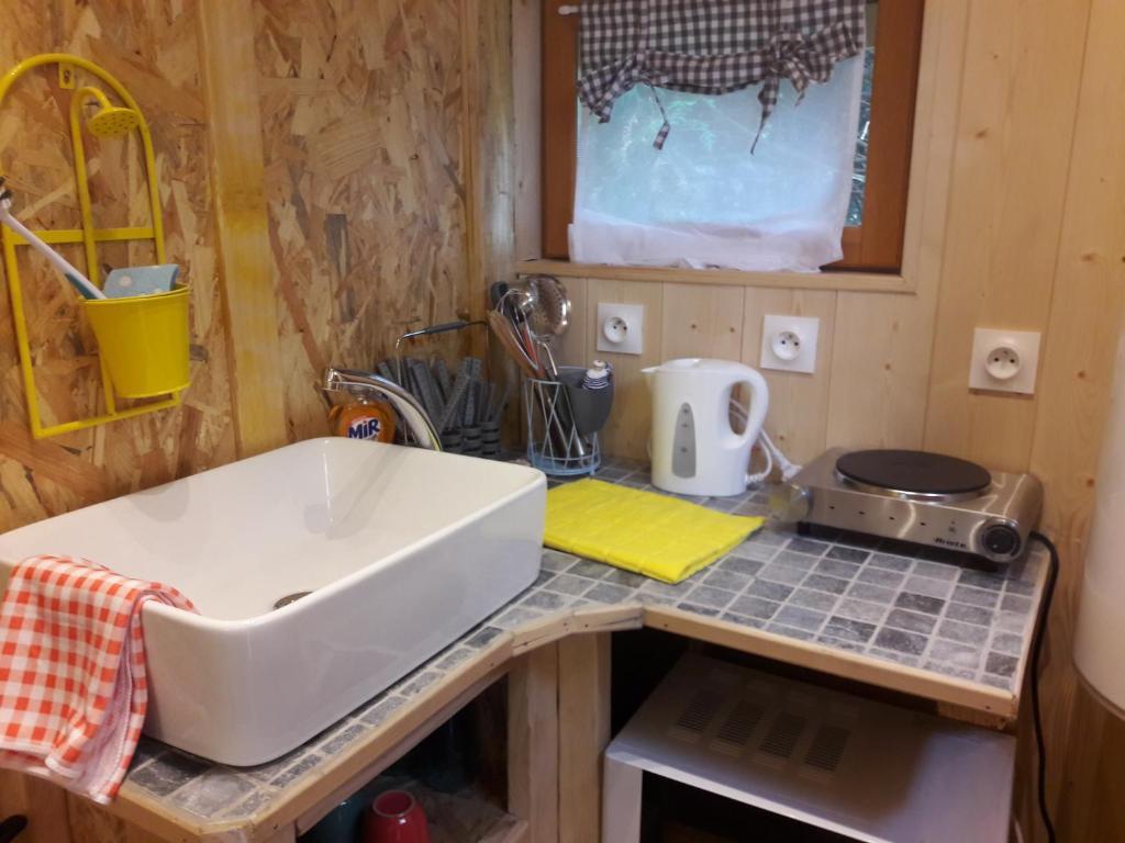 Salle de bains dans l'établissement Le Domi