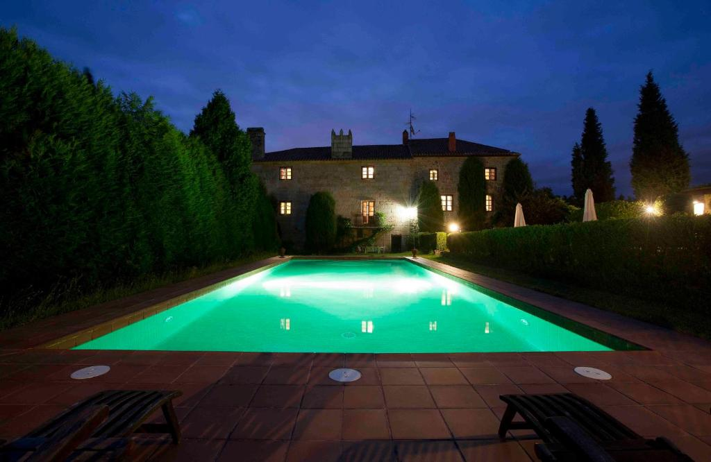 The swimming pool at or near Pazo de Bentraces