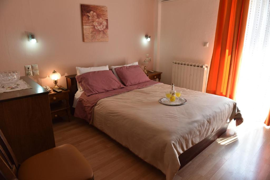 Ένα ή περισσότερα κρεβάτια σε δωμάτιο στο 40 Platania Hotel