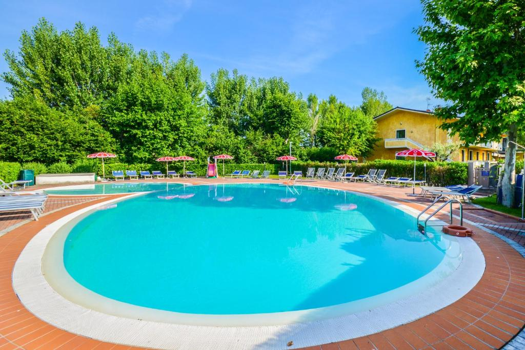 The swimming pool at or near Hotel Riel