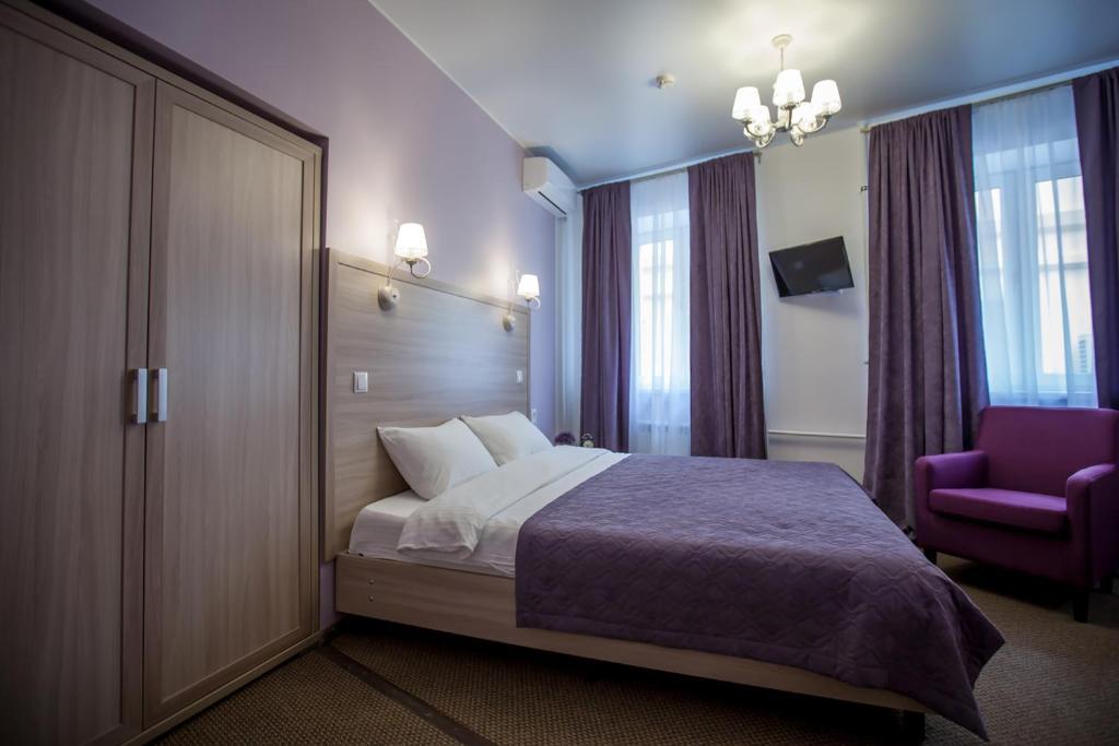 Кровать или кровати в номере Arbat Inn