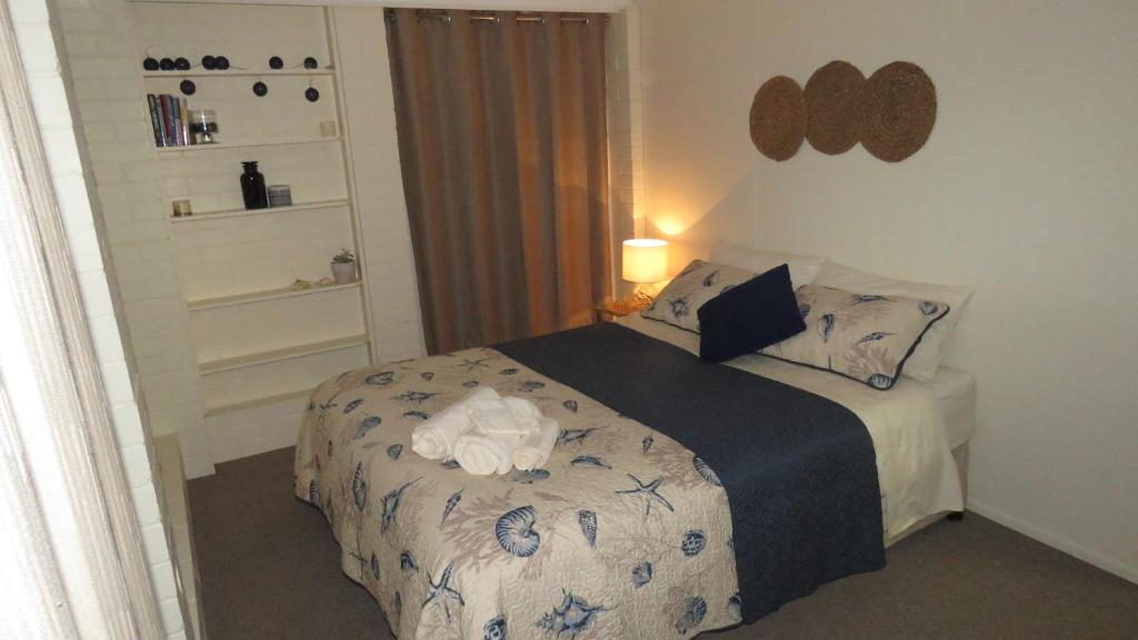 A bed or beds in a room at Homestay Guest Suite