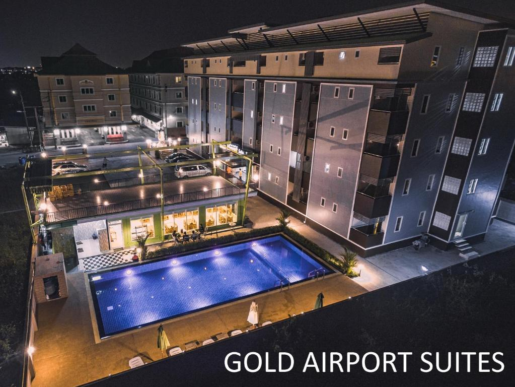 A view of the pool at Gold Airport Suites or nearby