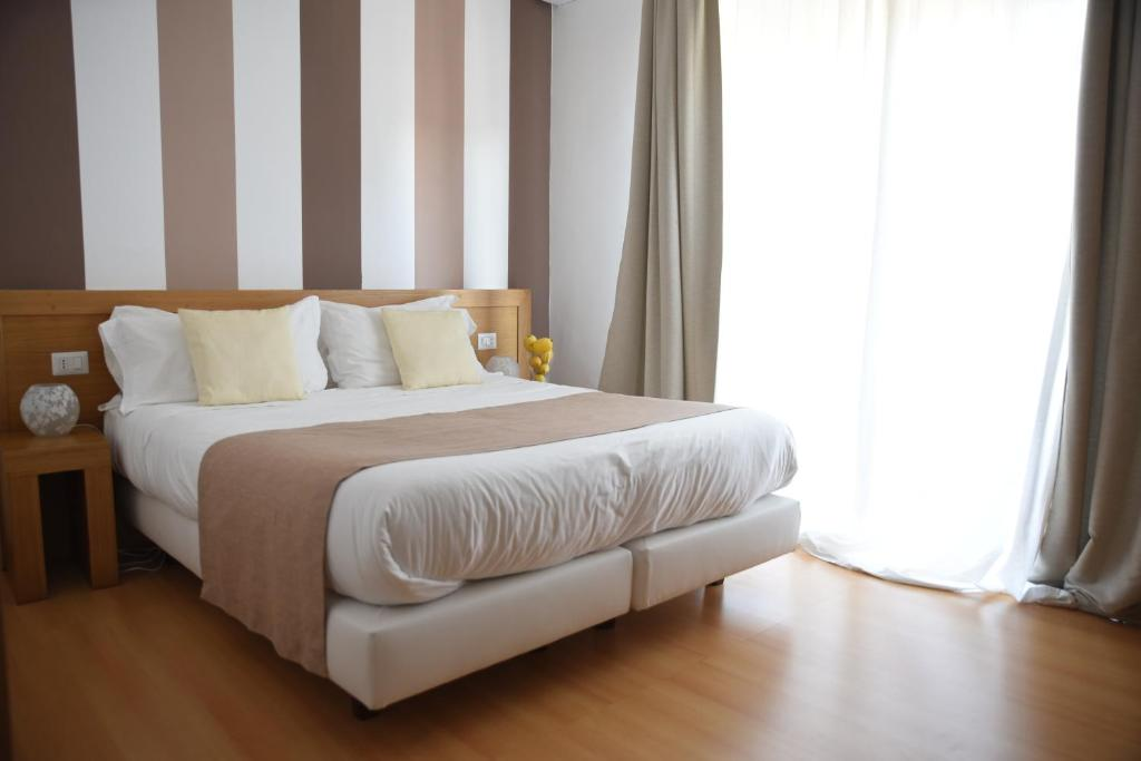 A bed or beds in a room at The Night Guest House