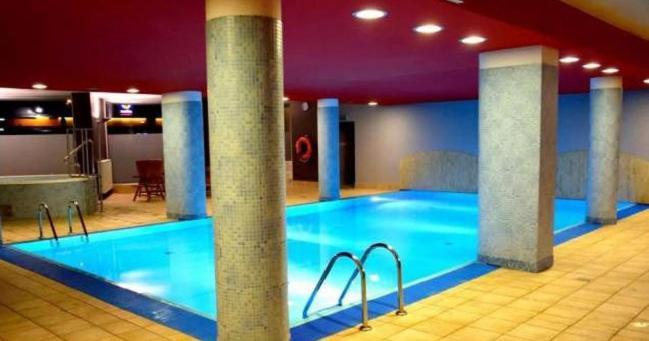 Basen w obiekcie Cracow City Apartments Verona lub w pobliżu