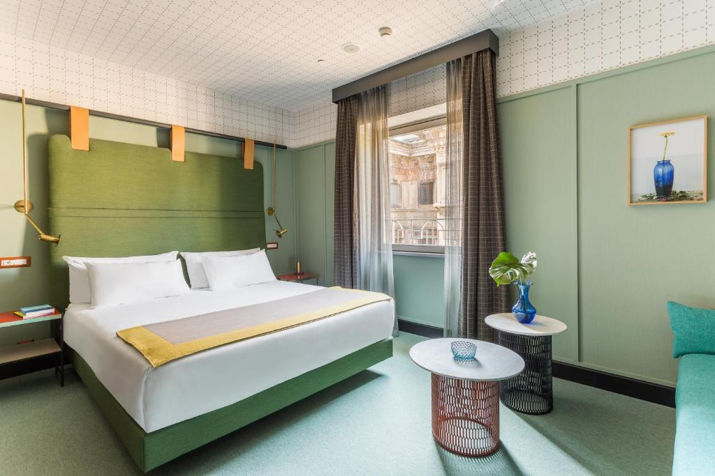 A bed or beds in a room at Room Mate Giulia