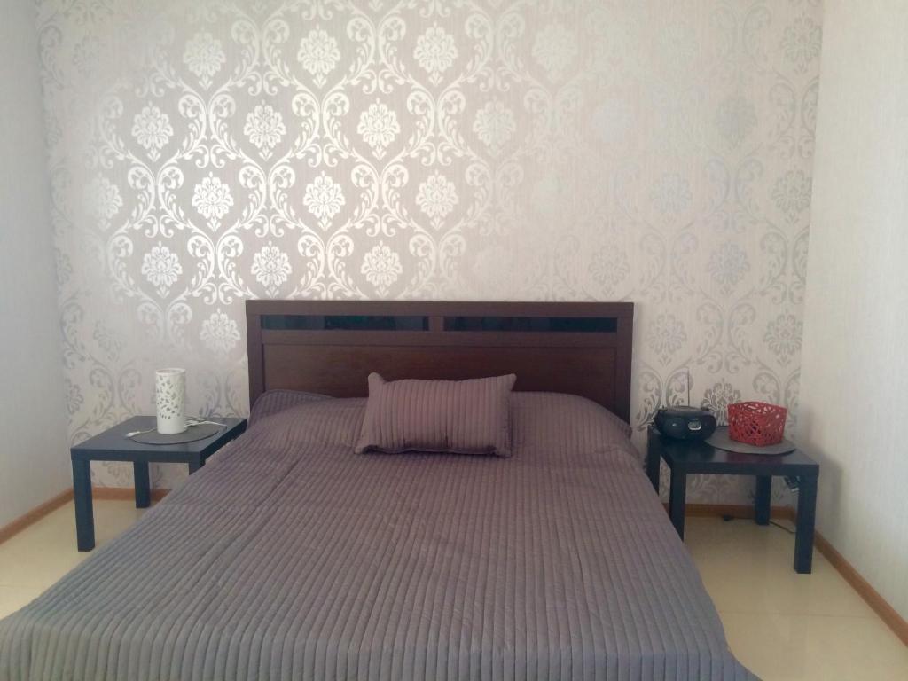 """Кровать или кровати в номере """"SUNRISE"""""""