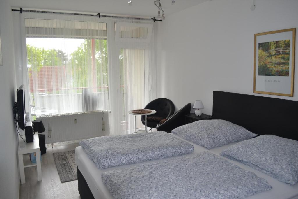 Ein Bett oder Betten in einem Zimmer der Unterkunft Ferienwohnung Resit 3
